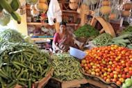A vendor waits for customers at a vegetable market in Hyderabad, 2011. Indian inflation rose in August to 7.55 percent on a 12-month basis, official data showed, further reducing the chances of an interest rate cut from the central bank next week
