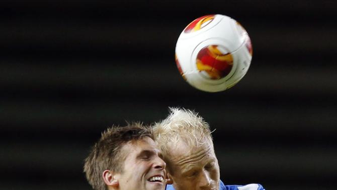 Elfsborg's Anders Svensson and Esbjerg's Hans Henrik Andreasen vie for the ball during the group C UEFA Europa League match IF Elfsborg vs Esbjerg fB at the Boras Arena in Boras, Sweden, Thursday Oct. 24, 2013.  (AP Photo / Adam Ihse / TT News Agency)