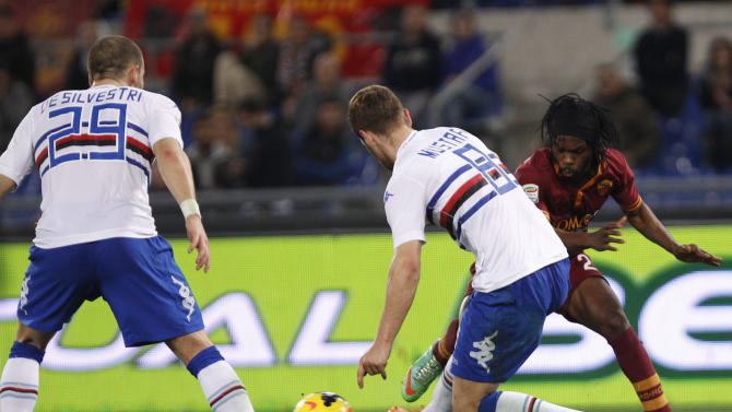 AS Roma forward Gervinho, of Ivory Coast, right, is challenged by Sampdoria defenders Shkodran Mustafi, of Germany, center, and Lorenzo De Silvestri during a Serie A soccer match between AS Roma and Sampdoria, at Rome's Olympic stadium, Sunday, Feb. 16, 2014