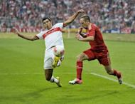 Stuttgart's Mexican defender Maza (L) and Bayern Munich's French midfielder Franck Ribery vie for the ball during the German first division Bundesliga football match. Bayern won 6-1