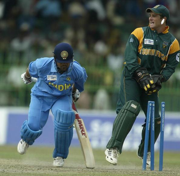 COLOMBO - SEPTEMBER 25:  Mark Boucher of South Africa runs out Sachin Tendulkar of India during the ICC Champions Trophy semi final match between India and South Africa at the Premadasa Stadium in Col