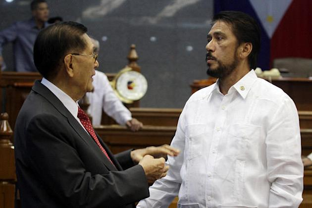 Senator Vicenter Sotto III (right) is seen with Senate President Juan Ponce Enrile at the plenary hall of the Senate in Pasay City, south of Manila, 10 September 2012. (Voltaire Domingo/NPPA Images)