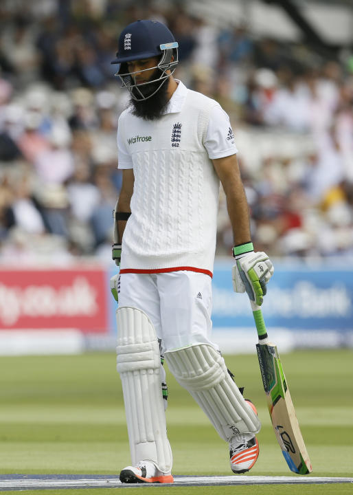 England's Moeen Ali walks off the pitch after being given out caught behind off the bowling of New Zealand's Trent Boult during play on the second day of the first Test match at Lord's cri