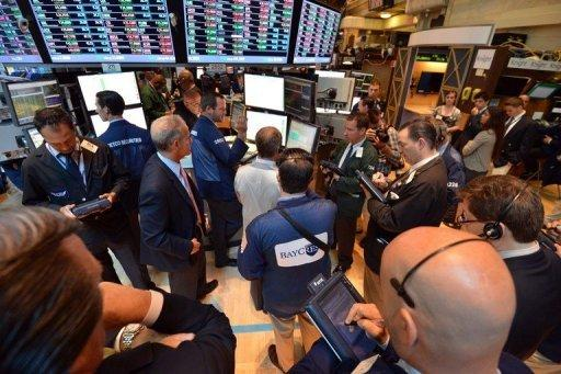 Traders at a post on the floor of the New York Stock Exchange just after the opening bell June 21
