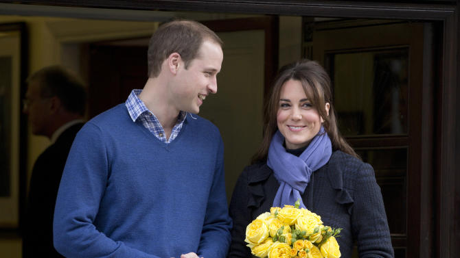 FILE - In this Thursday, Dec. 6, 2012 file photo Britain's Prince William stands next to his wife Kate, Duchess of Cambridge as she leaves the King Edward VII hospital in central London. He may be royal, but when it comes to paternity leave Prince William is in the same boat as everyone else. Like thousands of other new fathers in Britain, he will get two weeks off when his child is born. (AP Photo/Alastair Grant, File)