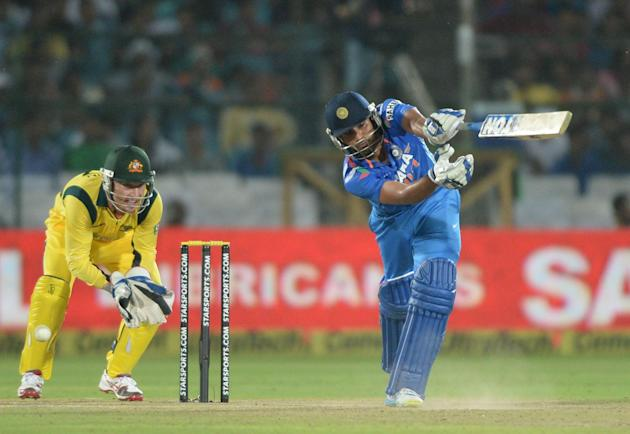 Indian batsman Rohit Sharma in action during the 2nd ODI match between India and Australia being played at Sawai Mansingh Stadium, Jaipur on Oct. 16, 2013. (Photo: IANS)