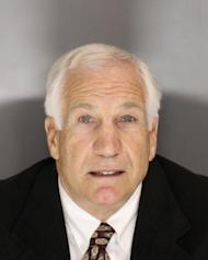 """This Nov. 5, 2011 booking photo released Wednesday, Dec. 7, 2011 by the Pennsylvania Office of Attorney General shows former Penn State football defensive coordinator Gerald """"Jerry"""" Sandusky, who was arrested and arraigned Wednesday, Dec. 7, 2011, on new sex abuse charges brought by two new accusers. (AP Photo/Pennsylvania Office of Attorney General)"""