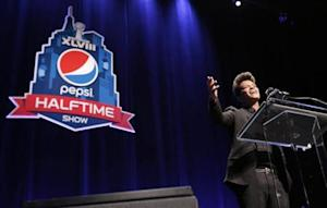 Singer Bruno Mars speaks at the Super Bowl half time press conference in New York
