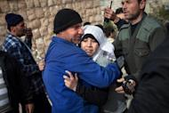 A girl cries outside a hospital in Kfar Nubul after hearing confirmation that her siblings died in an air strike on the town of Hass, in the northern Syrian province of Idlib, on February 14, 2013. Syria's army and rebels were preparing for a major battle for control of strategic airports in Aleppo, a watchdog said, four days after insurgents launched assaults on airbases in the northern province.