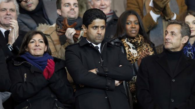 Deputy Mayor Anne Hidalgo, Nasser al-Khelaifi, Paris Saint Germain's club president and former French President Nicolas Sarkozy attend the French Ligue 1 soccer match between Paris Saint-Germain and FC Nantes at the Parc des Princes Stadium in Paris