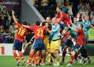 Spain's players celebrate at the end of their penalty shootout victory over Portugal in the Euro 2012 semi-final at the Donbass Arena in Donetsk, on June 27. Spain won 4-2 on penalties after the game finished 0-0 after extra-time