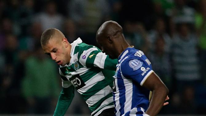 Sporting's Slimani, from Algeria, left, fights for the ball with Porto's Eliaquim Mangala, from France, during their Portuguese league soccer match Sunday, March 16 2014, at Sporting's Alvalade stadium in Lisbon. Slimani scored the goal in Sporting's 1-0 win