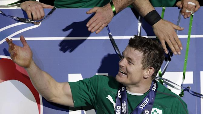 Ireland's Brian O'Driscoll, celebrates after defeating France and winning the Six Nations Rugby Union tournament at the stade de France stadium, in Saint Denis, outside Paris, Saturday, March 15, 2014. (AP Photo/Christophe Ena)