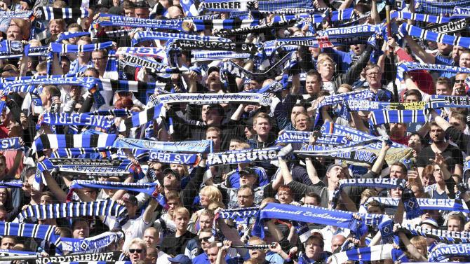 Hamburg SV supporters party in the stands ahead their German Bundesliga first division soccer match against Schalke 04 in Hamburg