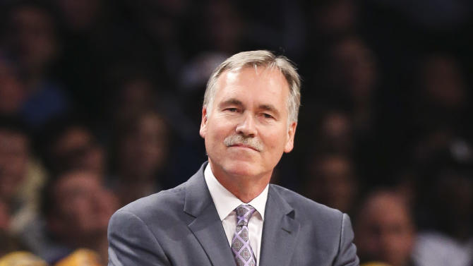 Los Angeles Lakers head coach Mike D'Antoni smiles in the second quarter of an NBA basketball game against the Brooklyn Nets at the Barclays Center, Wednesday, Nov. 27, 2013, in New York