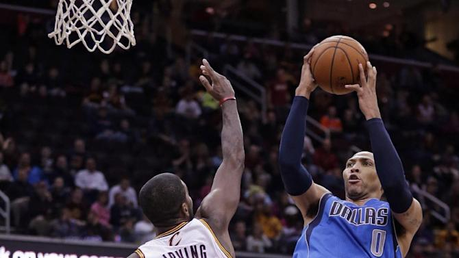 Dallas Mavericks' Shawn Marion (0) shoots  over Cleveland Cavaliers' Kyrie Irving (2) during the fourth quarter of an NBA basketball game Monday, Jan. 20, 2014, in Cleveland.  Dallas defeated Cleveland 102-97