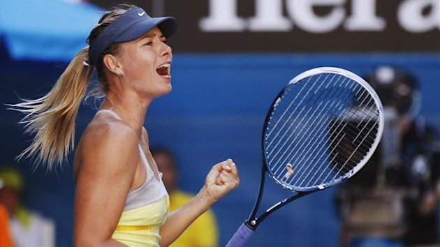 Maria Sharapova of Russia celebrates defeating compatriot Ekaterina Makarova in their women's singles quarter-final match at the Australian Open