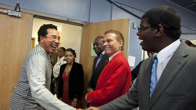Singer Smokey Robinson, left, is greeted at Duke Ellington School of the Arts in Washington, Friday, March 2, 2012. Robinson will perform at a benefit concert for the school on Saturday at the Kennedy Center. (AP Photo/Jacquelyn Martin)