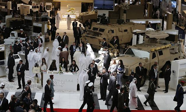 People visit during the opening of the International Defence Exhibition and Conference (IDEX) at the Abu Dhabi National Exhibition Centre in the Emirati capital on February 17, 2013. A top French defe