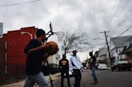 File photo shows teenagers playing basketball in Bridgeport, Connecticut. Nearly half of US teenagers say they'd much rather spend time with friends in the real world, a major survey published Tuesday indicated