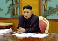 """This image released by North Korea's official Korean Central News Agency (KCNA) on January 27, 2013 shows North Korean leader Kim Jong-Un attending a security meeting at an undisclosed location in North Korea. YouTube said that a North Korean propaganda video showing New York City under attack had been removed from the site over a copyright complaint by the makers of the """"Call of Duty"""" video game"""