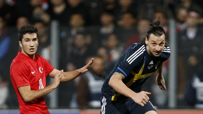 Sweden's Zlatan Ibrahimovic fights for the ball with Turkey's Nuri Sahin during their international friendly soccer match at 19 Mayis Stadium in Ankara