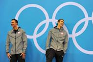 US swimmer Michael Phelps (R) laughs at the podium with silver medalist US swimmer Ryan Lochte (L) after winning the men's 200m individual medley swimming event at the London 2012 Olympic Games in London