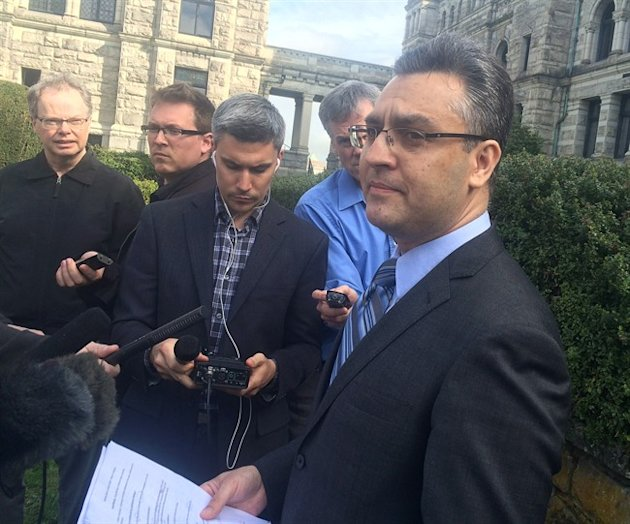 Saanich Mayor Richard Atwell talks to media outside the legislature in Victoria, Monday, March 30, 2015. British Columbia's privacy commissioner says a Vancouver Island municipality violated privacy rights by secretly installing computer spyware the mayor alleged was used to bug his computer. THE CANADIAN PRESS/Dirk Meissner