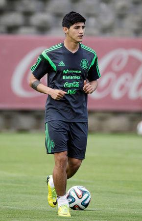 Mexico's striker Alan Pulido runs during a practice session in Mexico City