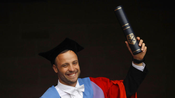South African paralympian Oscar Pistorius poses for photographers after receiving an Honorary Doctorate at the University of Strathclyde in Glasgow