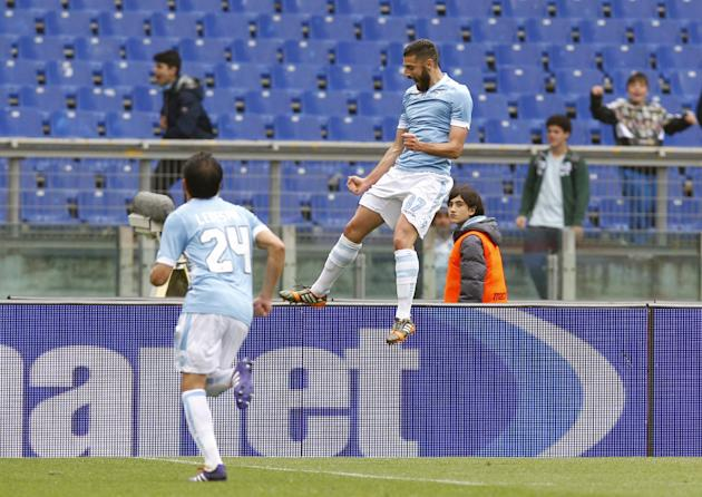 Lazio's Antonio Candreva, right, celebrates after scoring on a penalty during a Serie A soccer match between Lazio and Torino at Rome's Olympic stadium, Saturday, April 19, 2014