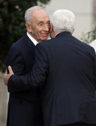 Israel's President Shimon Peres, left, and Palestinian President Mahmoud Abbas embrance each other during an evening of peace prayers in the Vatican gardens, Sunday, June 8, 2014. Pope Francis waded head-first into Mideast peace-making Sunday, welcoming the Israeli and Palestinian presidents to the Vatican for an evening of peace prayers just weeks after the last round of U.S.-sponsored negotiations collapsed. (AP Photo/Gregorio Borgia)