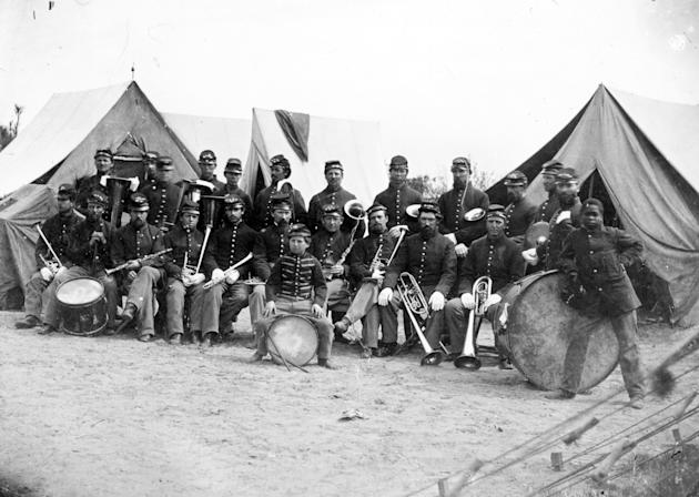 In this photo provided by the New Hampshire Historical Society the Third New Hampshire Regiment Band is seen in this 1800's photo taken by H.P. Moore. Music written for one of the best bands to serve