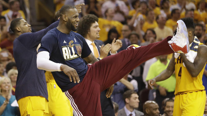 Cleveland Cavaliers forward LeBron James reacts on the sidelines late in the second half of Game 4 of the NBA basketball Eastern Conference Finals against the Atlanta Hawks, Tuesday, May 26, 2015, in Cleveland. (AP Photo/Tony Dejak)
