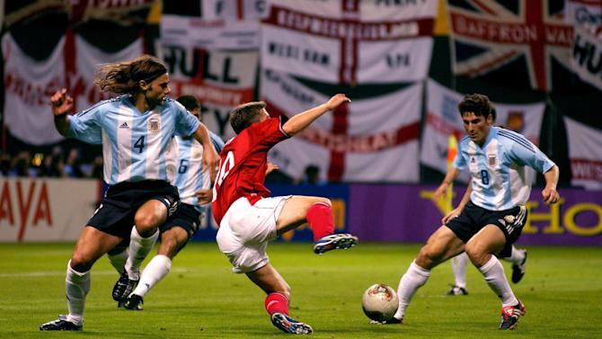 Michael Owen wins a penalty against Argentina at the 2002 World Cup