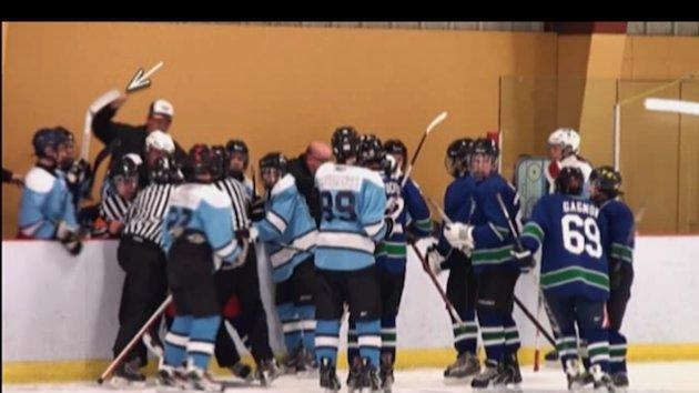 Still from video of Quebec minor hockey teams Chicoutimi Cougars and Jonquière Pumas during a brawl (video from CBC)