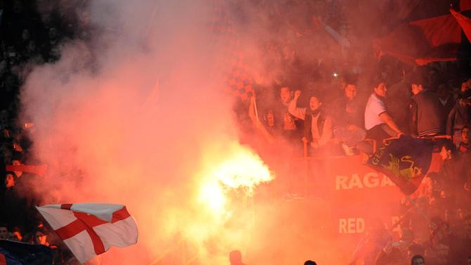 Genoa's fans light flares during their Italian Serie A soccer match against Juventus in Genoa