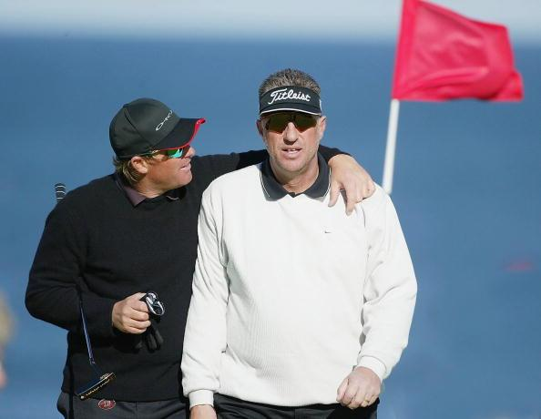 KINGSBARNS, SCOTLAND - SEPTEMBER  23:  Cricketers Shane Warne and Ian Botham practice for the Dunhill Links Championship on September 23, 2003 at Kingsbarns Golf Club near St Andrews, Scotland. (Photo
