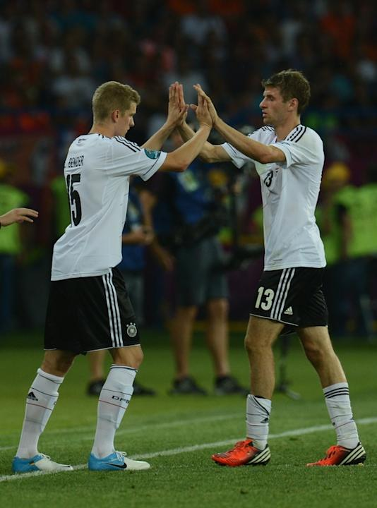 German Forward Thomas Mueller (R) Leaves AFP/Getty Images
