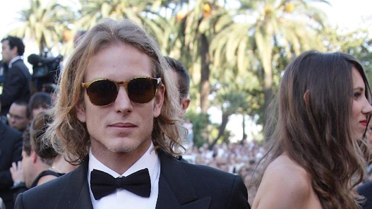 "FILE - Andrea Casiraghi, left, the eldest son of Princess Caroline of Hanover, seen with Tatiana Santo Domingo, right, in this May 24, 2006 file photo, arriving for the screening of the film ""Marie-Antoinette,"" at the 59th International film festival in Cannes, southern France.  A baby boy is the latest addition to this jet set royal family, it is announced Friday March 22, 2013, born to Andrea Casiraghi and his Colombian fiancee heiress Tatiana Santo Domingo. Mother and child are reported to be in good health. (AP Photo/Francois Mori, file)"