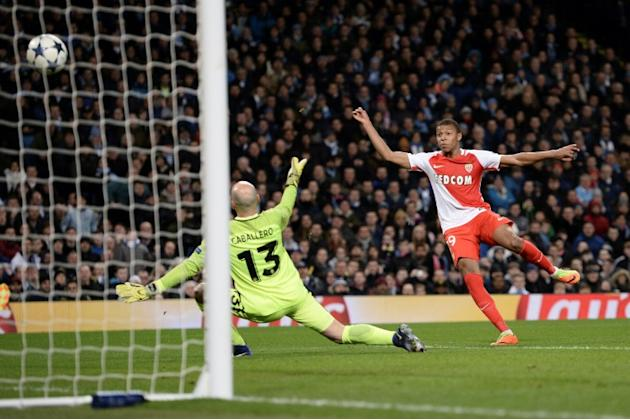 Monaco's forward Kylian Mbappe Lottin (R) scores their second goal during the UEFA Champions League Round of 16 first-leg football match between Manchester City and Monaco at the Etihad Stadium in