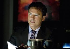 Arrow's John Barrowman on Malcolm Sharing His Dark Secret and His Epic, Lex Luthor-Like Agenda