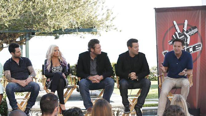"""This Sinday, Aug. 12, 2012 photo released by NBC shows from left,  coaches Adam Levine, Christina Aguilera, and Blake Shelton, host Carson Daly and producer Mark Burnett at a news coference for the singing competition series, """"The Voice,"""" in Malibu, Calif. Burnett said Sunday that the singing contest will let coaches """"steal"""" contestants from each other during the show's """"battle rounds."""" The show also will introduce a new """"knockout round"""" to slice the number of contestants on each coach's team. The third season of """"The Voice,"""" premieres on Sept. 10. (AP Photo/NBC, Chris Haston)"""
