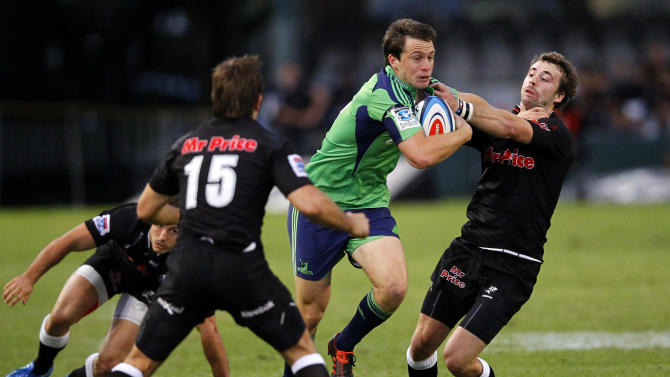 New Zealand Otago Highlanders' Ben Smith (R) tries to break a tackle from Durban Sharks' Tim Whitehead during the Super 15 Rugby Union match at the Kings Park Rugby Stadium in Durban on May 5, 2012.  AFP PHOTO / STRINGERSTRINGER/AFP/GettyImages