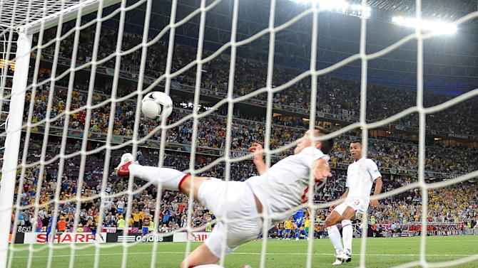 England's John Terry clears ball from beyond the goal-line in match against Ukraine