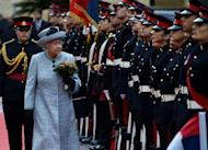 Queen Elizabeth reviews a Guard of Honor after her arrival in Malta for a three-day visit, on November 26, 2015