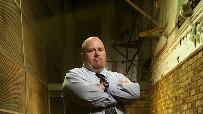 "Special Agent Joe England in ""The Squad: Prison Police."""