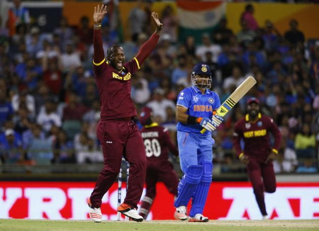 West Indies bowler Dwayne Smith reacts after India's Suresh Raina was caught behind by wicketkeeper Denesh Ramdin during their Cricket World Cup match in Perth