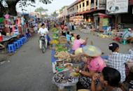 Residents buy food at a market in the town of Myitkyina, Kachin province, north of Yangon in May 2012. Myanmar will allow foreigners to take full ownership of local firms under a new investment law expected to be approved by parliament soon, a senior official said Wednesday