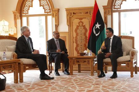 First Deputy President of Libya's General National Congress Ezzedine Muhammad Yunus al-Awami meets with U.S. Deputy Secretary of State William Burns at the headquarters of the National General Con